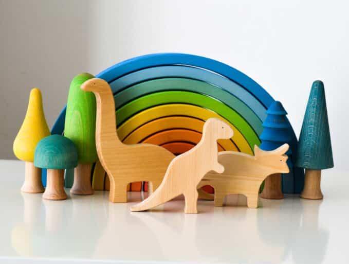 Ocamora dinosaurs, trees and rainbow