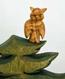 Predan large wooden owl in tree