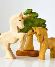 Predan wooden unicorns and leafy tree